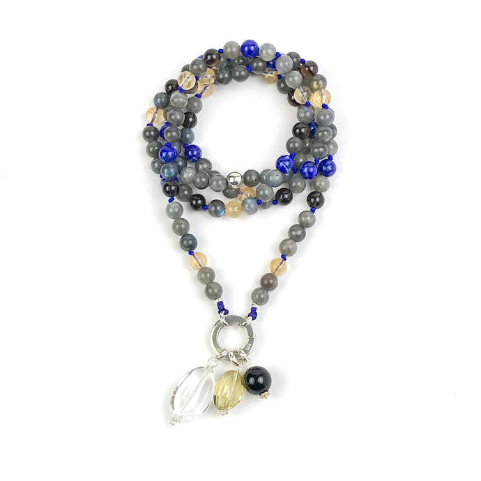 This mala necklace was created with beautiful 8mm Lapis Lazuli, Labradorite, Citrine, and Smoky Quartz beads. It comes with a Crystal Quartz charm like the one pictured (other charms are for show only and can be purchased separately).
