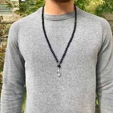Load image into Gallery viewer, This mala necklace features 6mm Onyx and Black Lava beads. The guru is handwired with .925 Sterling Silver and features a round Onyx bead followed by a Crystal Quartz bead.