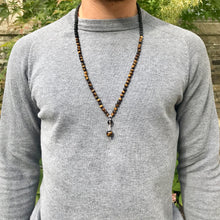Load image into Gallery viewer, This mala necklace features 6mm frosted matte Tiger Eye and Black Lava beads. The guru is handwired with .925 Sterling Silver and features round Smoky Quartz and Tiger Eye beads.
