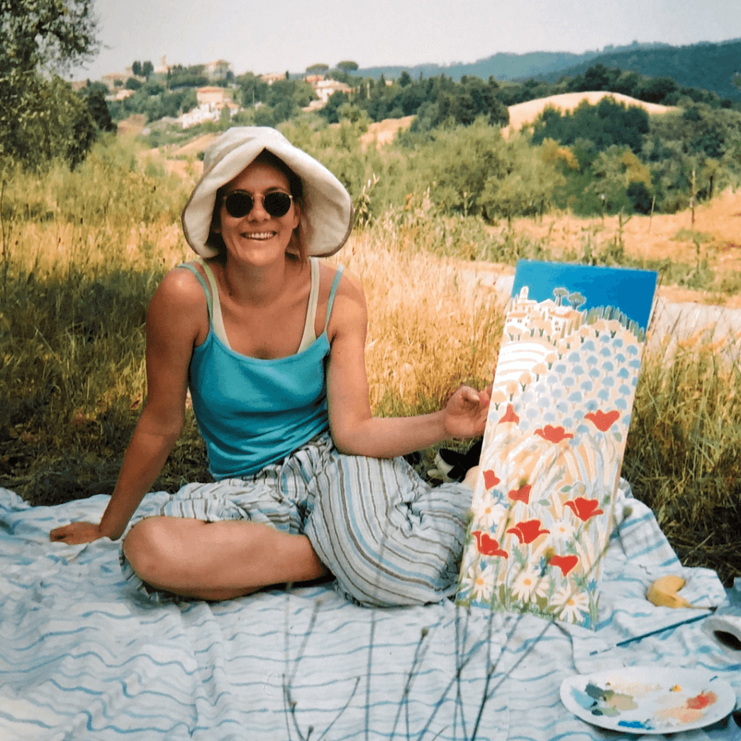 British artist Joanne Short, the UK's leading colourist oil painter, pictured in Italy working en plein air on an oil painting of the Italian landscape.