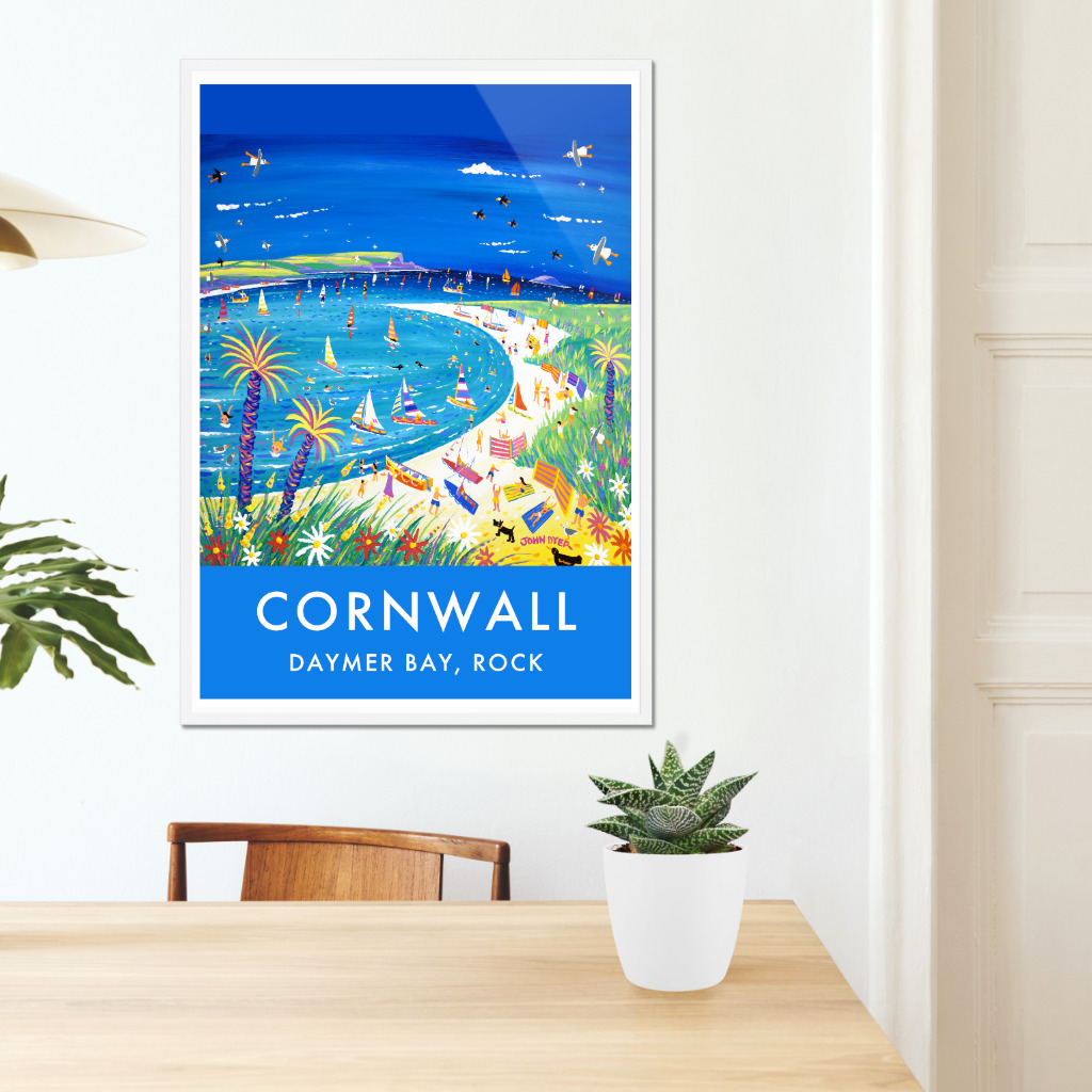 Cornish artist John Dyer pictured next to his art posters on the King Harry Ferry, Cornwall