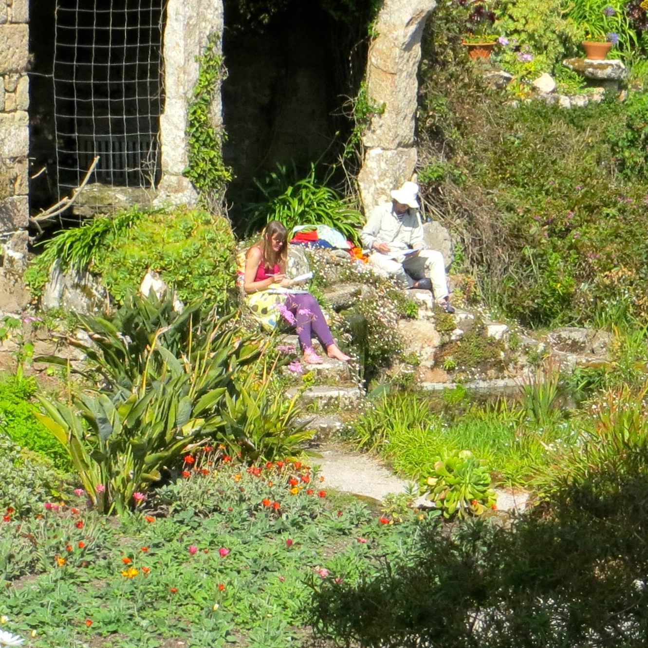Cornish artists Joanne Short and John Dyer painting in the Tresco Abbey Gardens in Cornwall