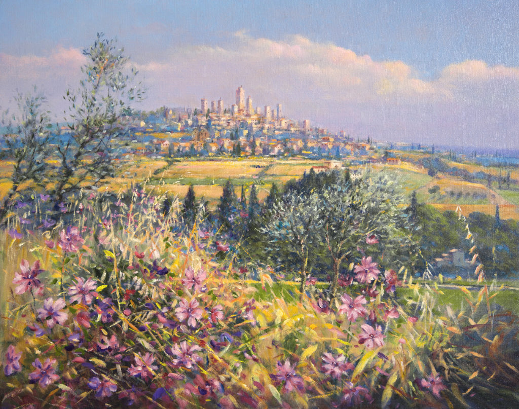 The painting brings the light, colours and textures of Italy to all who view. Wild flowers fill the foreground of the canvas and olive trees and pencil pines create a stage for the spectacular vista of the village of San Gimignano beyond. This painting is one that will bring the best of Tuscany and the best of Ted Dyer's art into your home. Perfect.