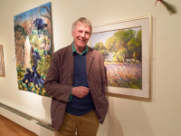Artist Ted Dyer in the Falmouth Art GAllery with his painting 'Lavender-time, Provence'.