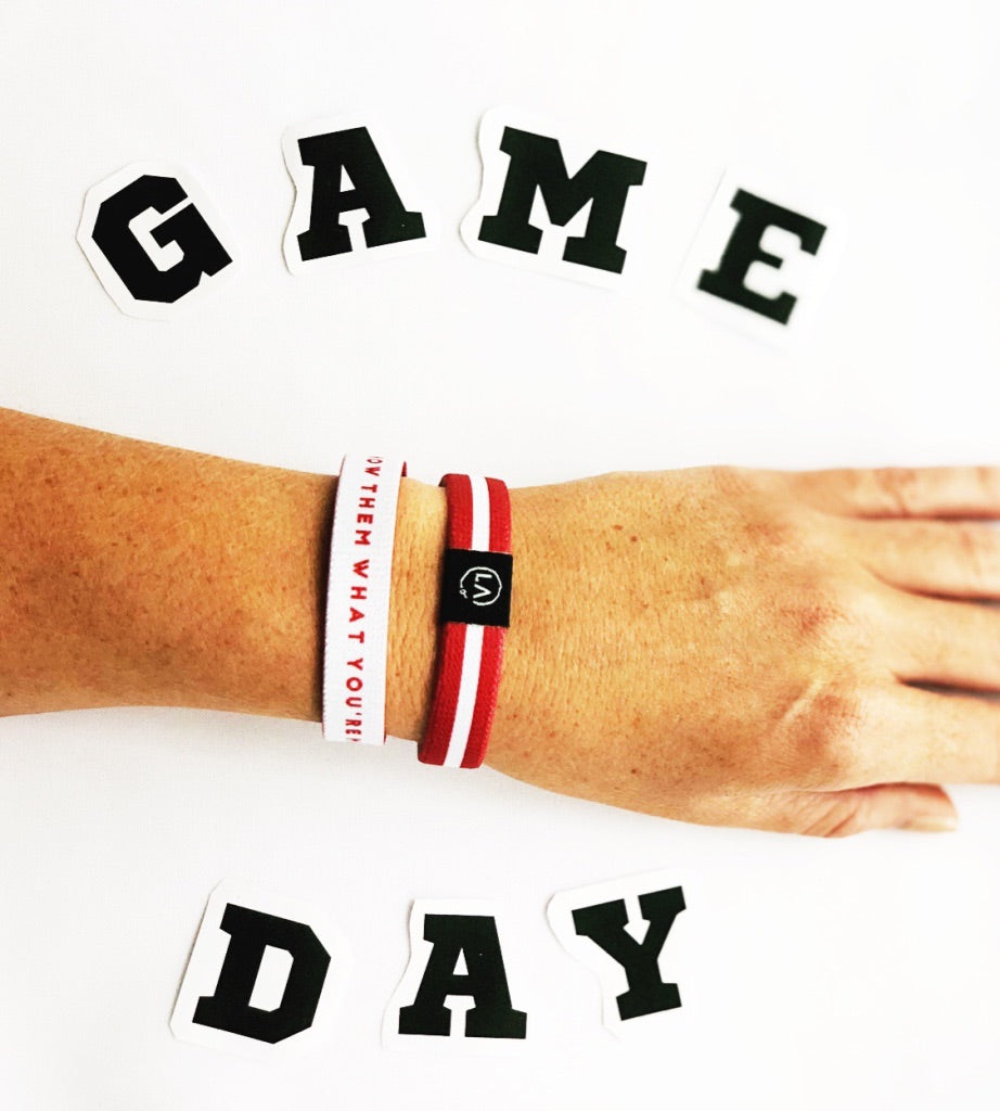 Be your teams number one fan and showcase the best spirit wear at the tailgate when you sport your teams colors on you wrist with this Refocus Band!