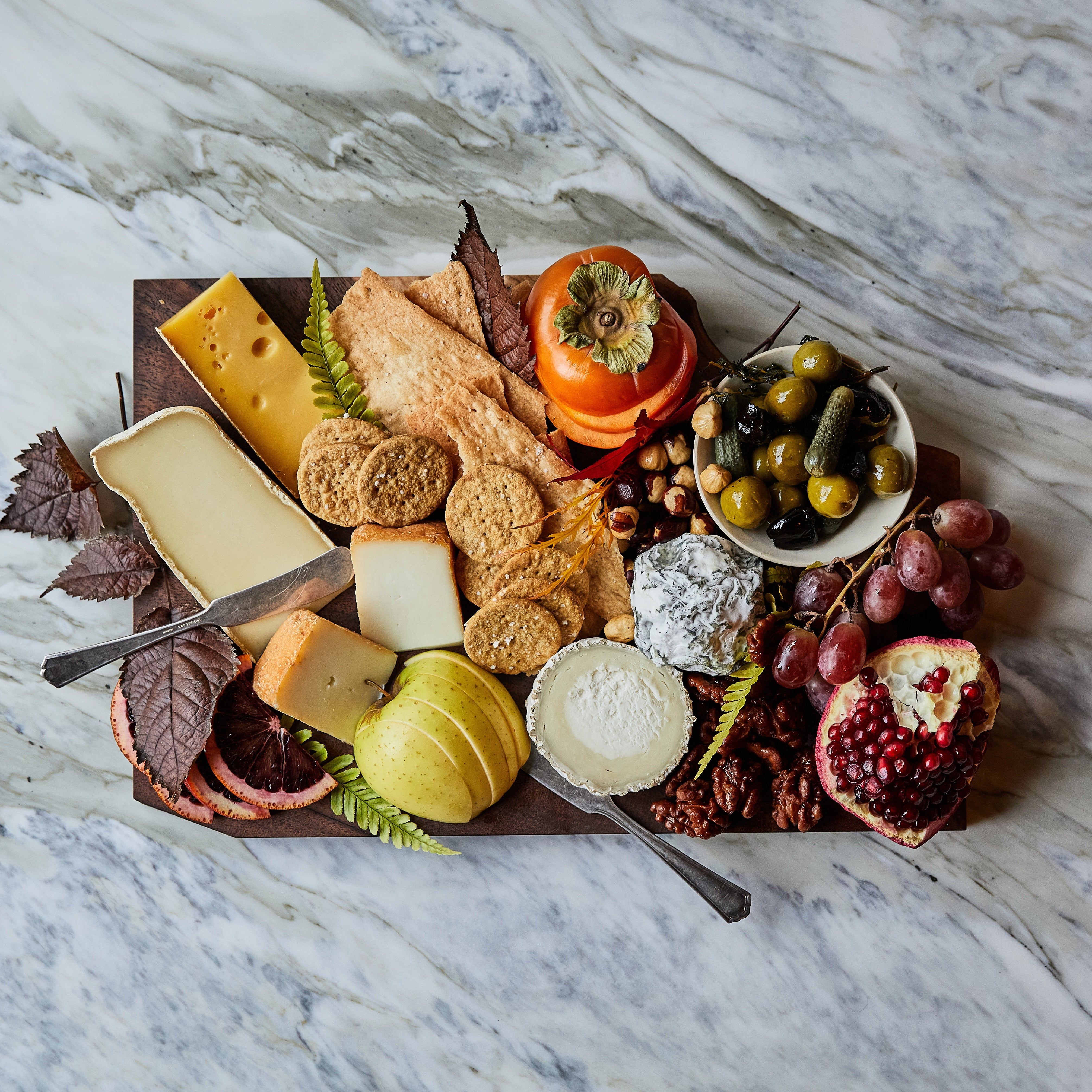 Cheese Platter with Crackers, fruits and nuts