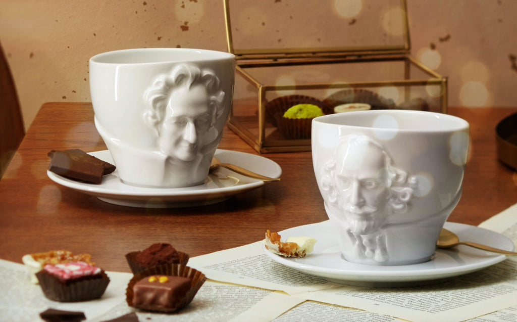 TALENT Series porcelain cups featuring portraits of Mozart, Beethoven, Shakespeare, Wagner, and Goethe in lifelike detail. Quality porcelain cups Made in Germany from finest porcelain by FIFTYEIGHT PRODUCTS.