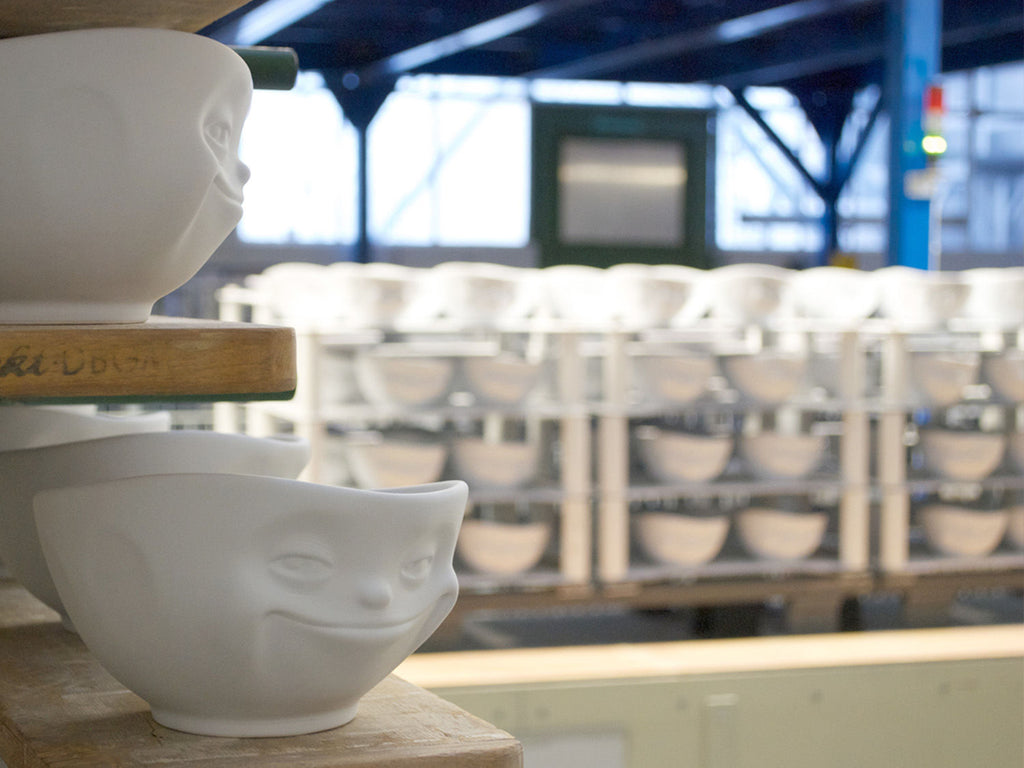 Mixed porcelain bowls by FIFTYEIGHT PRODUCTS, including cereal bowls, salad bowls and small egg cups.