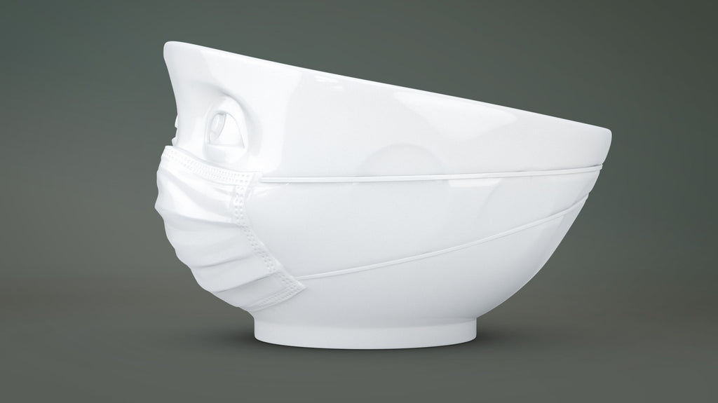The HOPEFUL porcelain bowl by FIFTYEIGHT Products is a cereal bowl wearing a PPE face mask, with 1 EUR donated to relief efforts from each bowl sold.