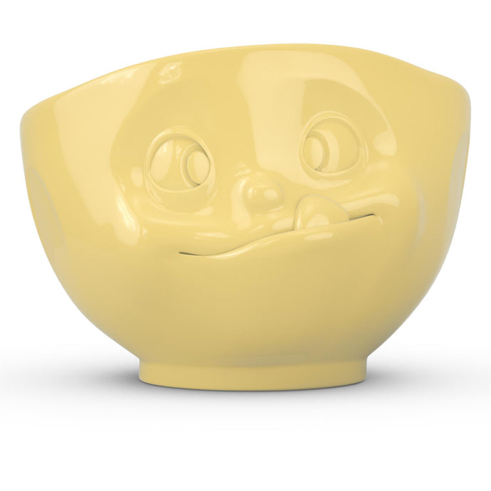 16 ounce capacity porcelain bowl in yellow featuring a sculpted 'tasty' facial expression. From the TASSEN product family of fun dishware by FIFTYEIGHT Products. Quality bowl perfect for serving cereal, soup, snacks and much more.