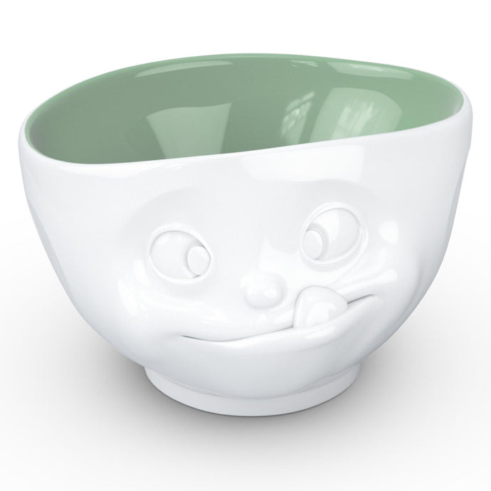 16 ounce capacity porcelain bowl in white with pine color inside featuring a sculpted 'tasty' facial expression. From the TASSEN product family of fun dishware by FIFTYEIGHT Products. Quality bowl perfect for serving cereal, soup, snacks and much more.