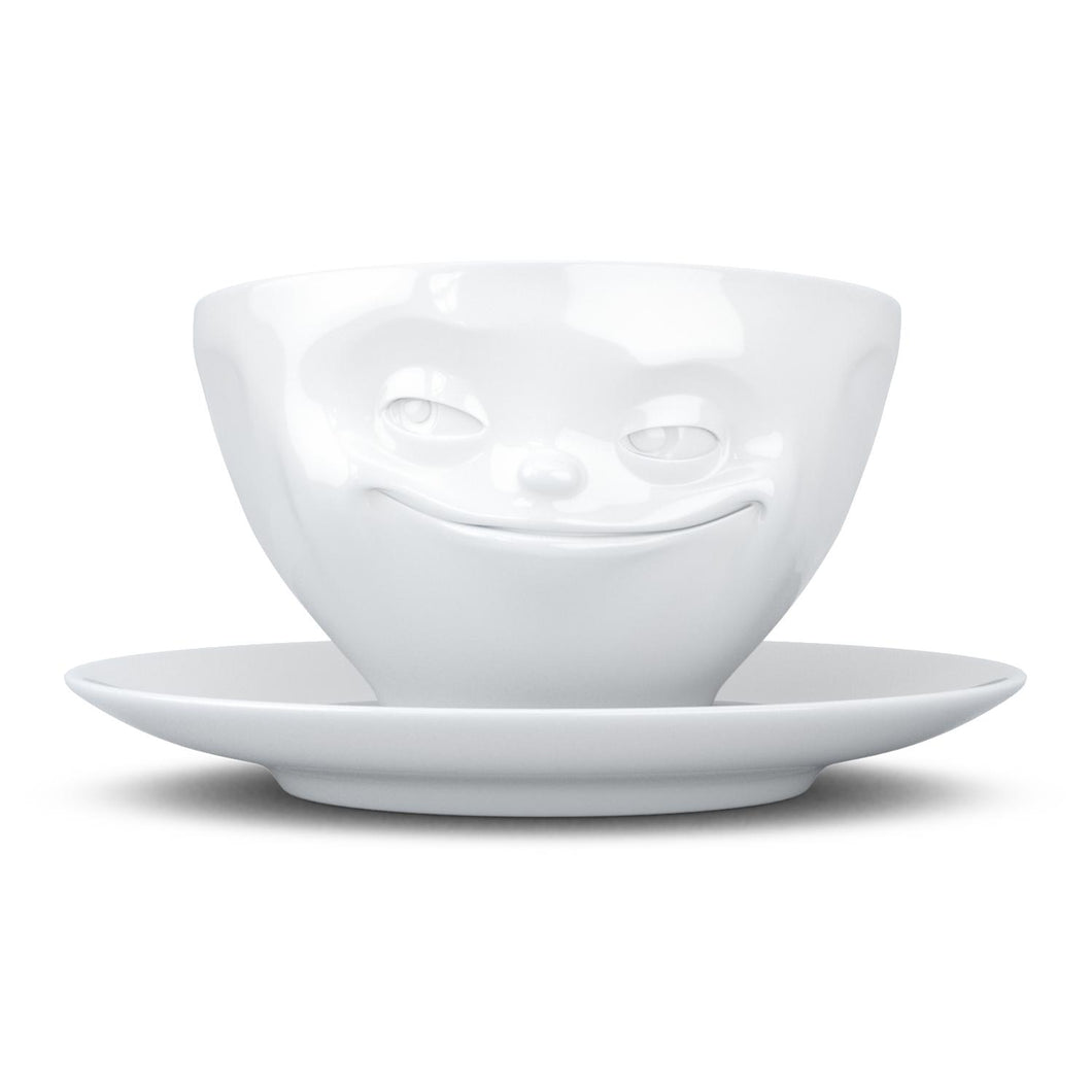 Coffee cup with a 'grinning' facial expression and 6.5 oz capacity. From the TASSEN product family of fun dishware by FIFTYEIGHT Products. Coffee cup with matching saucer crafted from quality porcelain.