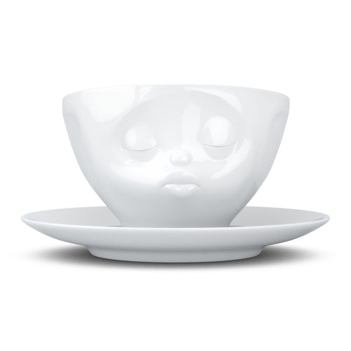 Coffee cup with a 'kissing' facial expression and 6.5 oz capacity. From the TASSEN product family of fun dishware by FIFTYEIGHT Products. Coffee cup with matching saucer crafted from quality porcelain.
