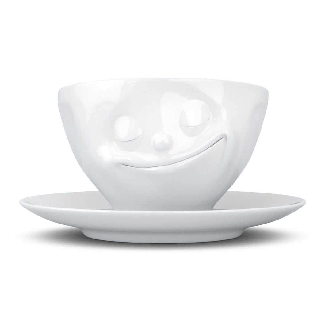 Coffee cup with a 'happy' facial expression and 6.5 oz capacity. From the TASSEN product family of fun dishware by FIFTYEIGHT Products. Coffee cup with matching saucer crafted from quality porcelain.