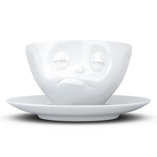 Coffee cup with a 'snoozy' facial expression and 6.5 oz capacity. From the TASSEN product family of fun dishware by FIFTYEIGHT Products. Coffee cup with matching saucer crafted from quality porcelain.