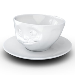 Coffee cup with a 'tasty' facial expression and 6.5 oz capacity. From the TASSEN product family of fun dishware by FIFTYEIGHT Products. Coffee cup with matching saucer crafted from quality porcelain.
