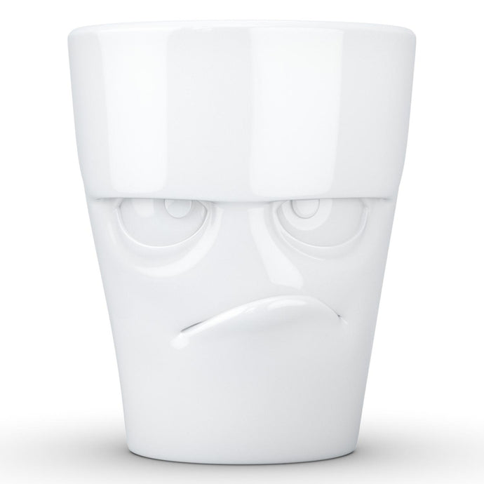 Coffee mug with 'grumpy' facial expression and 11 oz capacity. From the TASSEN product family of fun dishware by FIFTYEIGHT Products. Tall coffee cup with handle in white, crafted from quality porcelain.