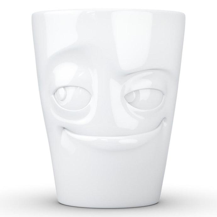 Coffee mug with 'impish' facial expression and 11 oz capacity. From the TASSEN product family of fun dishware by FIFTYEIGHT Products. Tall coffee cup with handle in white, crafted from quality porcelain.