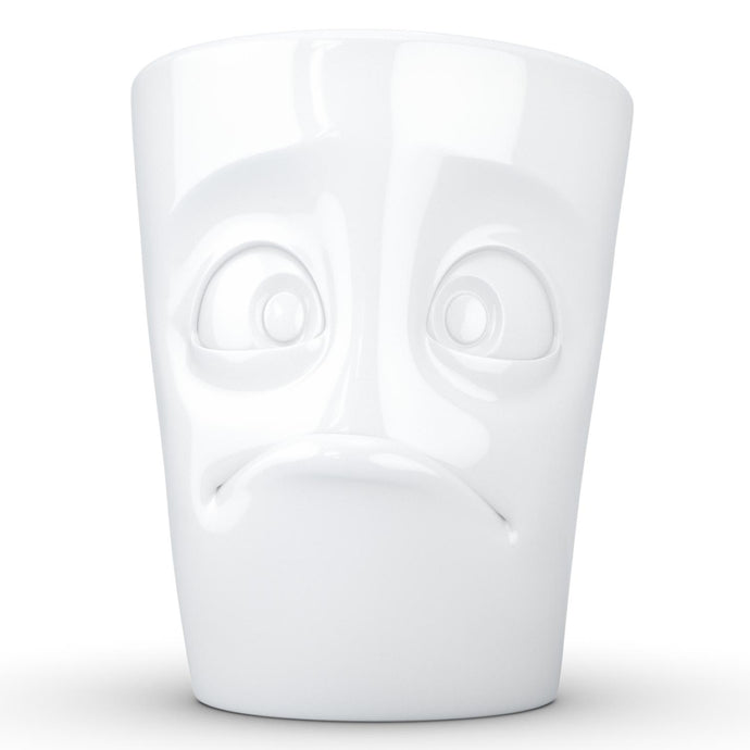 Coffee mug with 'baffled' facial expression and 11 oz capacity. From the TASSEN product family of fun dishware by FIFTYEIGHT Products. Tall coffee cup with handle in white, crafted from quality porcelain.