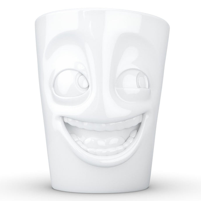 Coffee mug with 'joking' facial expression and 11 oz capacity. From the TASSEN product family of fun dishware by FIFTYEIGHT Products. Tall coffee cup with handle in white, crafted from quality porcelain.