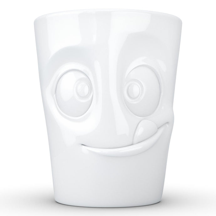 Coffee mug with 'tasty' facial expression and 11 oz capacity. From the TASSEN product family of fun dishware by FIFTYEIGHT Products. Tall coffee cup with handle in white, crafted from quality porcelain.