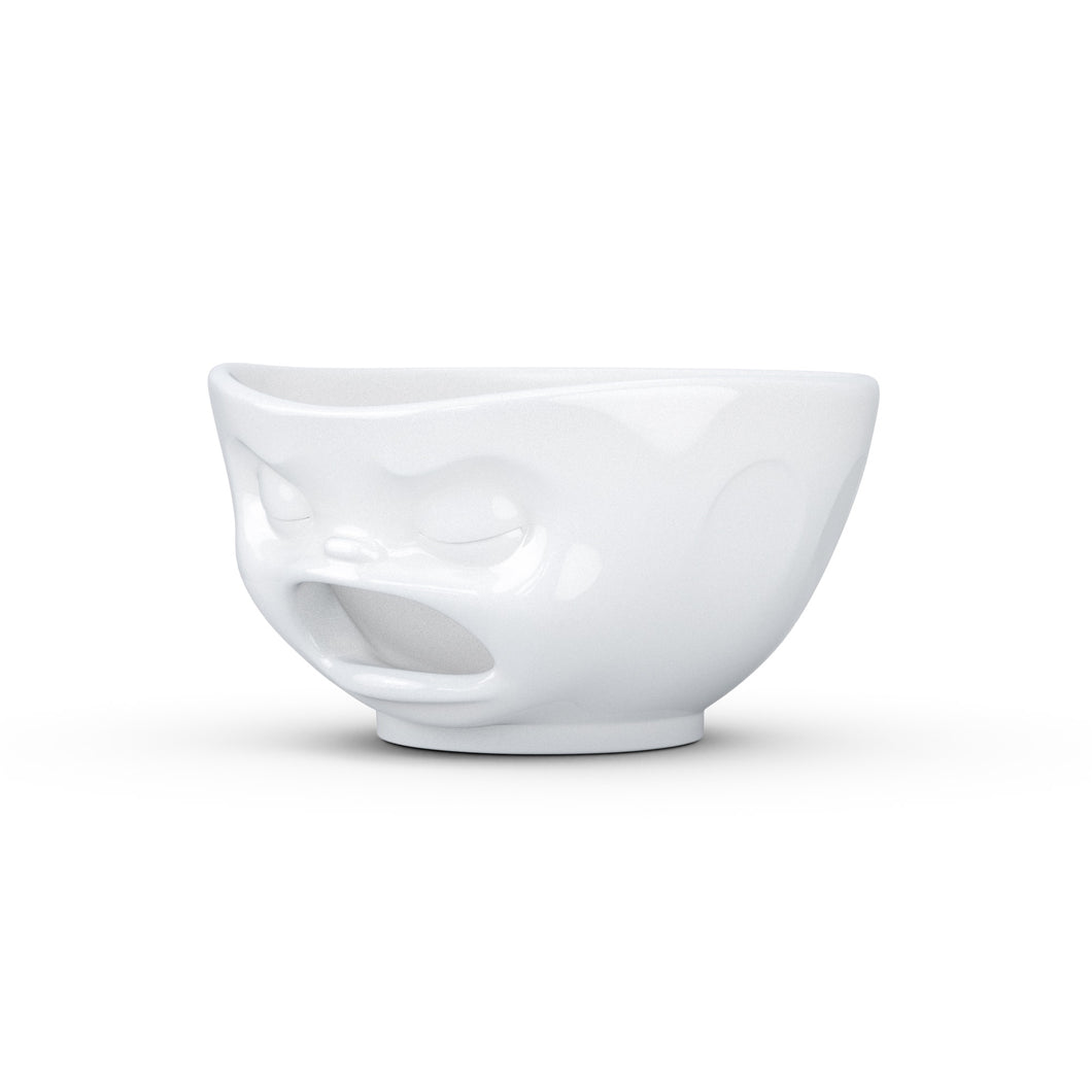 Premium extra large porcelain bowl in white from the TASSEN product family of fun dishware by FIFTYEIGHT Products. Offers 33 oz capacity with hole in front for fun effect to serve snacks. Dishwasher and microwave safe bowl featuring a sculpted 'barfing' facial expression. Shipped in exclusively designed gift box.