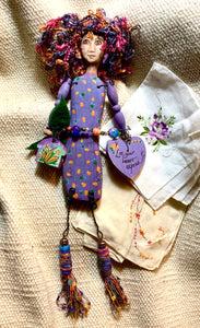 """Let your heart expand"" mixed media doll"