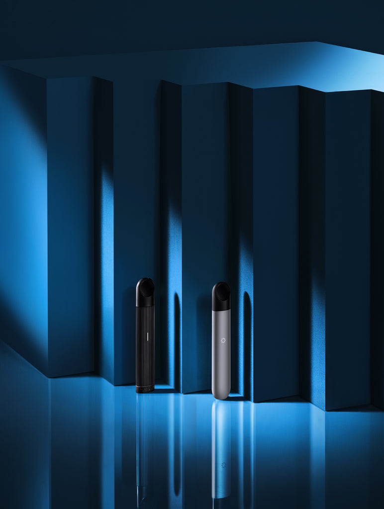 Two RELX Vaping Device in front of blue background