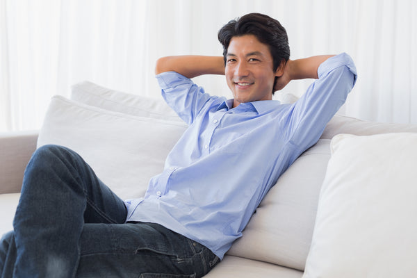Man relaxing on couch at home