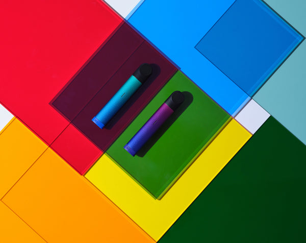 Two RELX devices on colorful paper