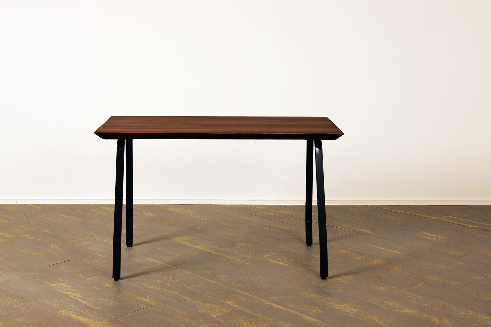 The Arthropod Bevel Desk in Warm Brown and Clear Coat