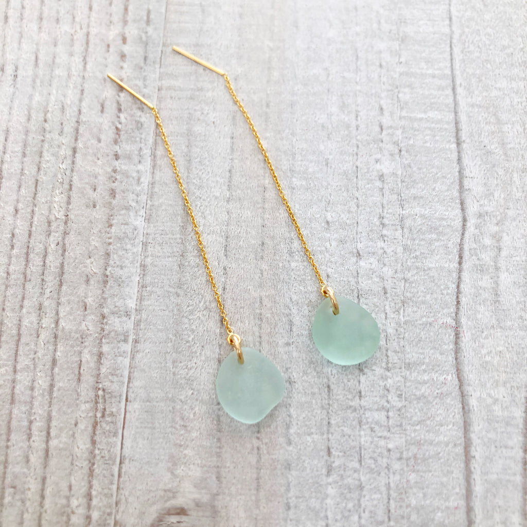Aqua sea glass on gold filled ear threads.