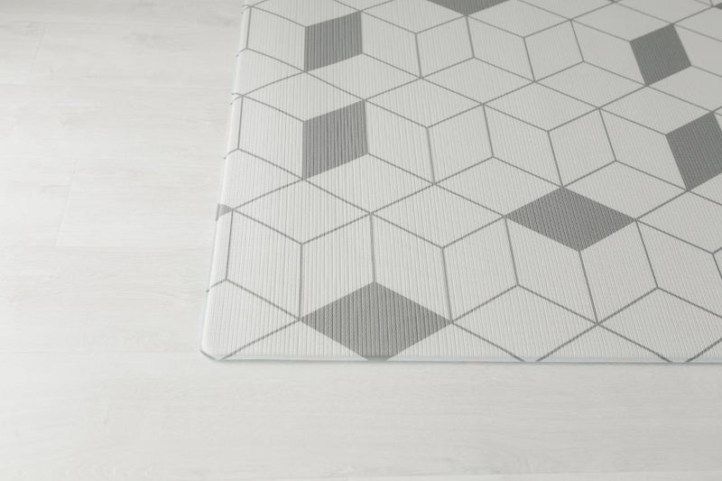 Padded baby play mat with different grey designs on each side