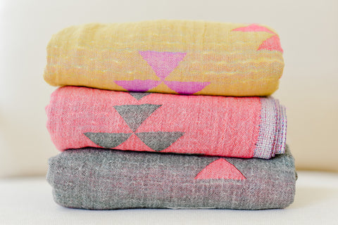 Turkish towels are the original towel made for the beach, home decor, fashion and more. A mothers favourite diaper bag accessory for the stroller cover, nursing cover and swaddle blanket.