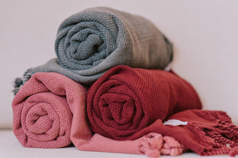 Turkish towels rolled up make for space saving ideas and the plush, cozy, ultra-soft Turkish cotton is very absorbent but also quick to dry.