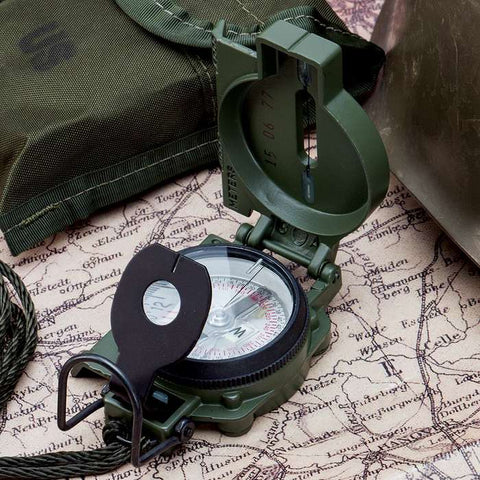 Cammenga 3H G.I. Military Tritium Lensatic Compass on a map with other equipment.
