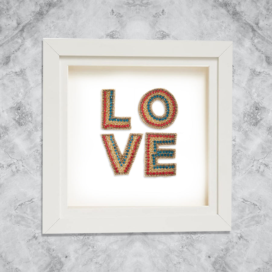L O V E Stacked multicoloured crystal mini letters on White