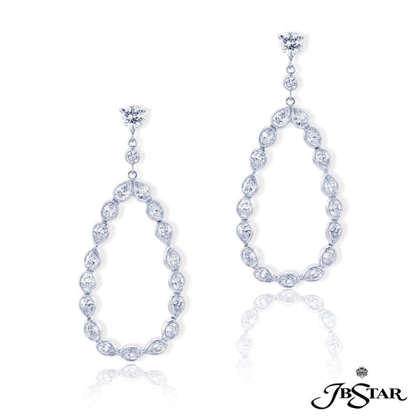1951-001 Diamond hoop earrings handcrafted in a combination of carefully matched oval and pear-shaped diamonds to form the perfect hoop. Platinum.