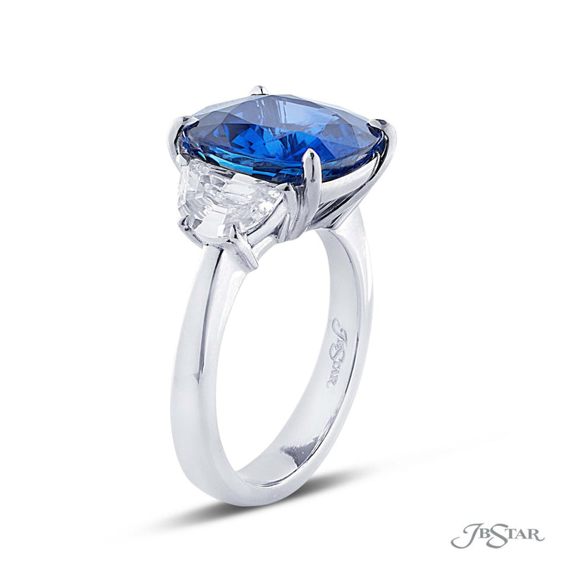 Magnificent sapphire and diamond ring featuring a 7.36 ct. certified Sri Lankan cushion cut sapphire embraced between two half moon diamonds.