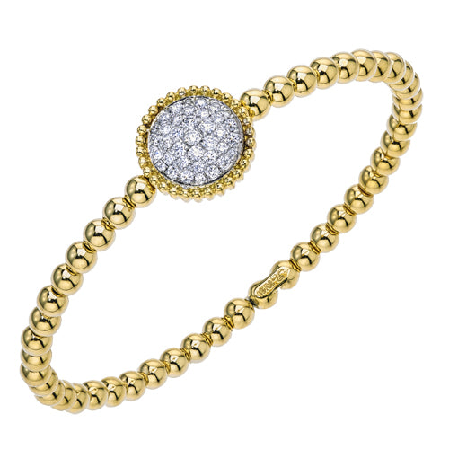 18kt yellow gold beaded cuff bracelet with round diamonds.