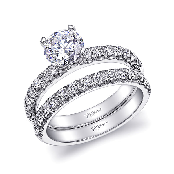 An Elegant Wedding Set With Fishtail-Set Diamonds