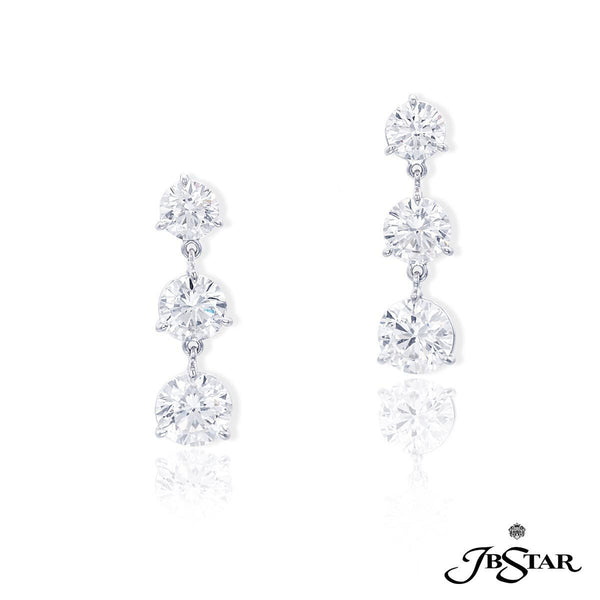 Platinum diamond earrings handcrafted with perfectly matched cascading diamonds.