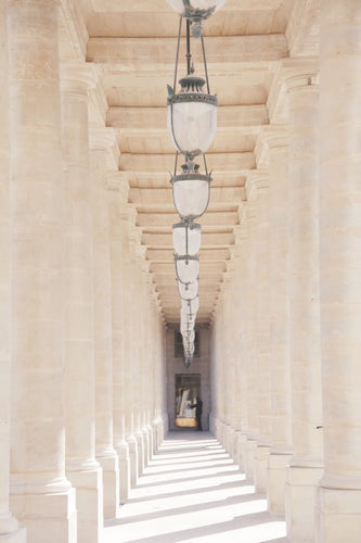 Palais Royal colonnade Paris France neutral white cream colours, row of hanging lanterns.