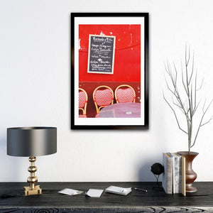 Red Café wall in Montmartre Paris with menu board and French café table and chairs