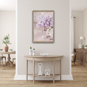 Lilac flowers arranged in a vintage style jardiniére vase Wall hall table console