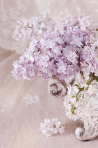 Lilac flowers arranged in a vintage style jardiniére vase