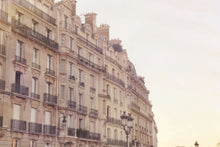 Load image into Gallery viewer, Golden Haussmann buildings along the seine river in Paris. Afternoon sunset pastels