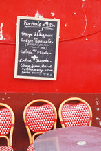 Load image into Gallery viewer, Red Café wall in Montmartre Paris with menu board and French café table and chairs