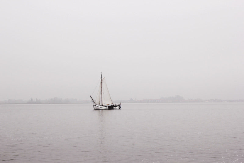 sailboat on the Gouwzee lake in the netherlands spring morning mist grey wall art photography