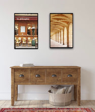 Load image into Gallery viewer, arched gallery at the place des vosges in the marais paris france. café les philosophes